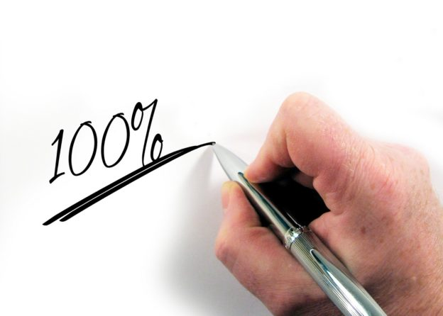 "Brian Britt ""Your 401K"" blog post image of a hand writing 100 percent"